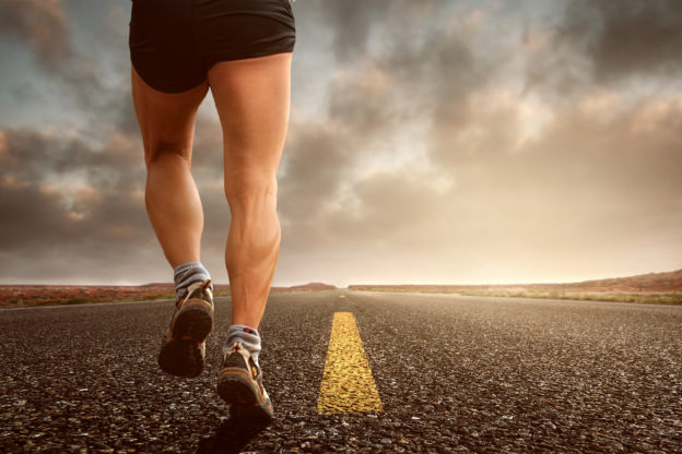Athlete running with good foot and ankle biomechanics for injury prevention. Runners