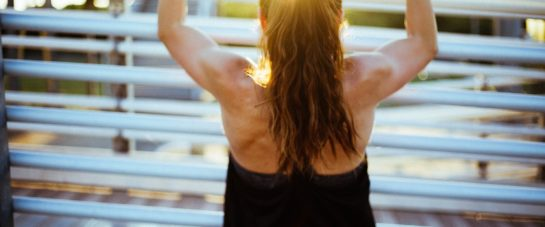 Muscle burn and soreness in female doing exercises.
